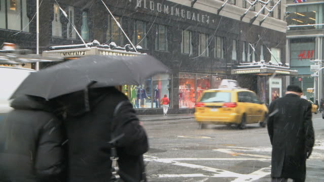 ws pedestrians and traffic passing by bloomingdales during winter / new york city, new york, usa - bloomingdales stock videos & royalty-free footage