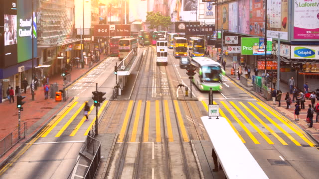 tl zo pedestrians and tram in central hongkong - tram stock videos & royalty-free footage