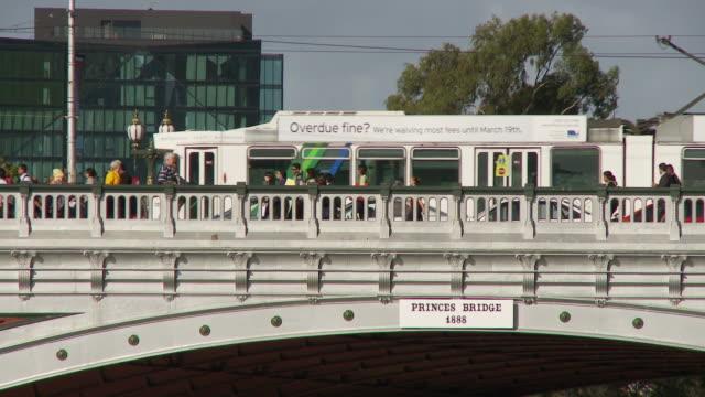 ms pedestrians and tram passing through princes bridge / melbourne, victoria, australia - road sign stock videos & royalty-free footage