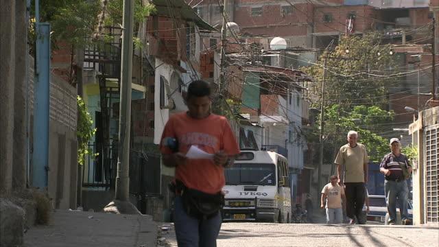 WS Pedestrians and truck passing through Federico Quiroz street / Metropolitan District of Caracas, Miranda, Venezuela