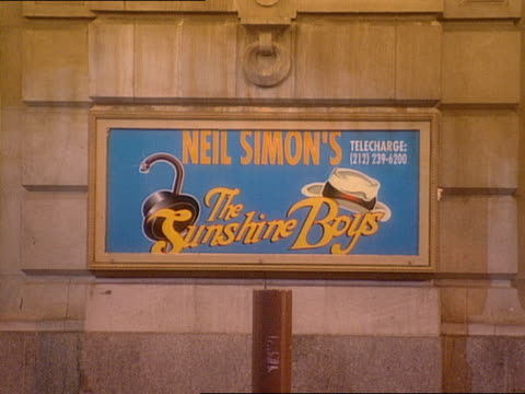 pedestrians and vehicles pass in front of neil simon's the sunshine boys sign posted on the lyceum theater. - scriptwriter stock videos & royalty-free footage