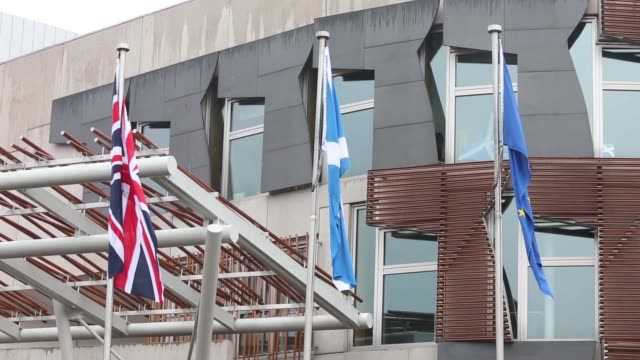 Pedestrians and vehicles pass the Scottish parliament building in the Holyrood area of Edinburgh UK on Saturday Sept 20 A Scottish or Saltire flag...