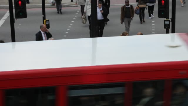 pedestrians at a crossing on euston road, london, uk. - road junction stock videos & royalty-free footage