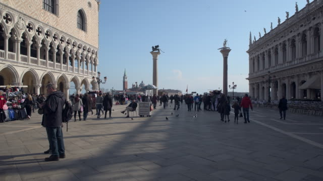 Pedestrians at Piazza San Marco (St Mark's square) with the Doge's Palace.