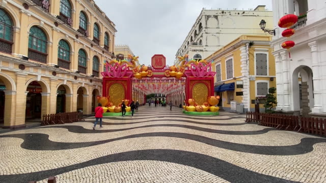 pedestrians at senado square wearing protective masks because of coronavirus epidemic, macau, china, on wednesday, february 5, 2020. - leal senado square stock videos & royalty-free footage