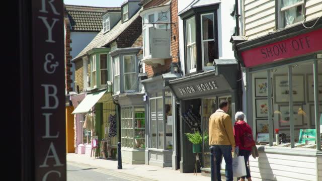 vídeos y material grabado en eventos de stock de pedestrians browsing shops in whitstable, uk - boutique