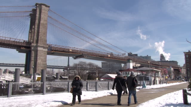 pedestrians bundled up from record cold weather in nyc, go for a stroll at the fulton street ferry landing in brooklyn bridge park, on a frigid... - bundle stock videos & royalty-free footage