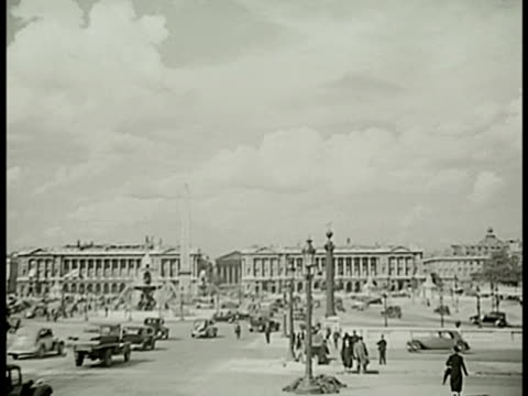 stockvideo's en b-roll-footage met pedestrians cars in place de la concorde obelisk ws row of french people sitting at outdoor cafe talking eating waiters ws notredame cathedral buses... - 1938