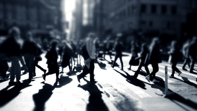 pedestrians commuting in the city. busy crow of people walking through town. lagre shadows of people. - pedestrian stock videos & royalty-free footage