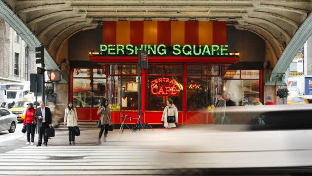 pedestrians cross a street in front of the pershing square caf_ on 42nd street in manhattan, new york. - 42nd street stock videos & royalty-free footage