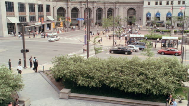 pedestrians cross a street near public square in cleveland, ohio. - square stock videos & royalty-free footage