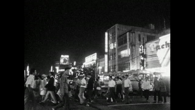 pedestrians cross a wide city street in tokyo; 1966 - incidental people stock videos & royalty-free footage