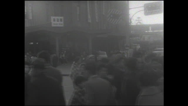 stockvideo's en b-roll-footage met pedestrians cross an intersection near the east gate of shinjuku station. - 1961