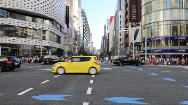 pedestrians cross at ginza crossing - ginza stock videos & royalty-free footage