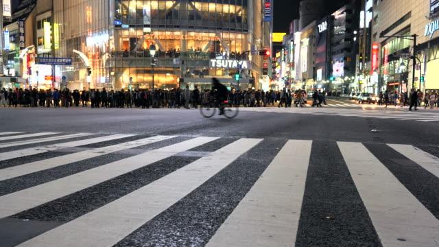 Pedestrians cross at Tokyo Shibuya Crossing
