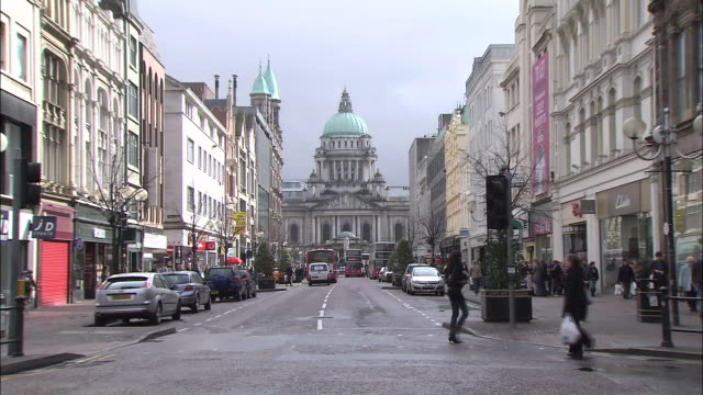 pedestrians cross central street in belfast. - belfast stock videos & royalty-free footage