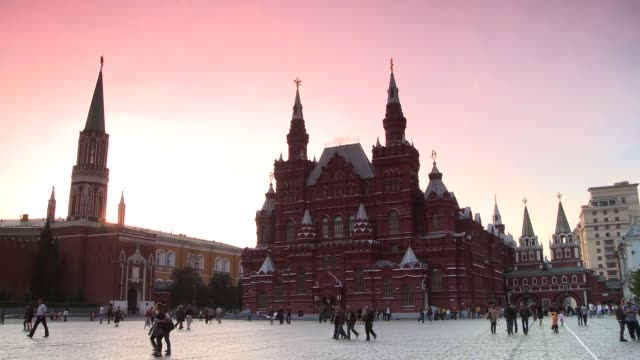 Pedestrians cross in front of the State Historical Museum near the Red Square in Moscow, Russia. Available in HD.