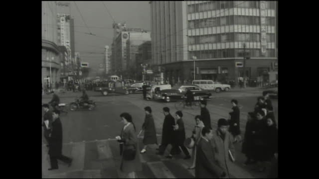 pedestrians cross the street at an intersection. - showa period stock videos & royalty-free footage