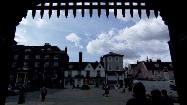 pedestrians cross under a gate into the market town of bury st edmunds. available in hd. - bury st edmunds stock videos & royalty-free footage