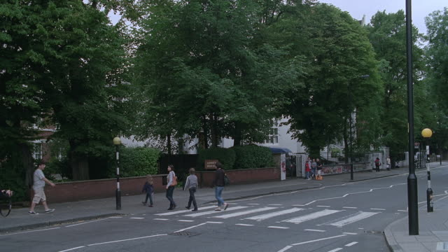 ws pedestrians crossing abbey road / london, england, united kingdom - zebra crossing stock videos & royalty-free footage