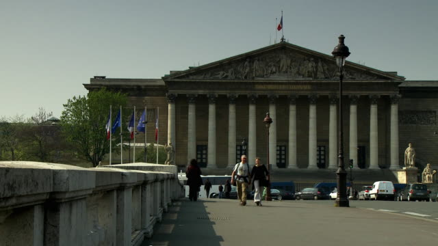 WS Pedestrians crossing bridge with National Assembly in background, Paris, France