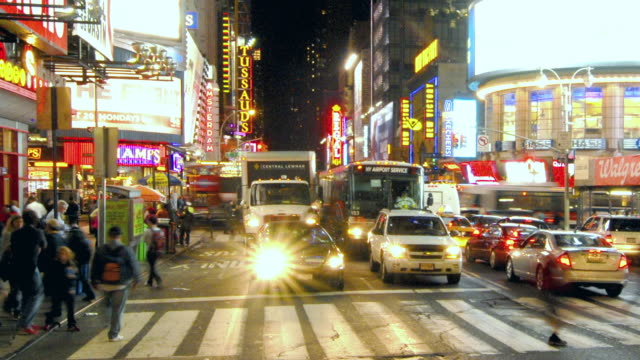 t/l pedestrians crossing busy 42nd street / new york city, new york, united states - 42nd street stock videos & royalty-free footage