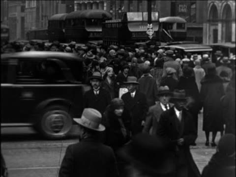 b/w 1921 pedestrians crossing busy city street / documentary - 1921 stock videos & royalty-free footage