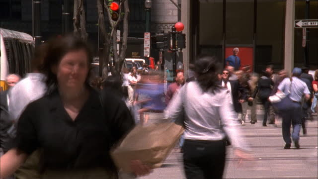 pedestrians crossing busy city street - mpeg video format stock videos & royalty-free footage