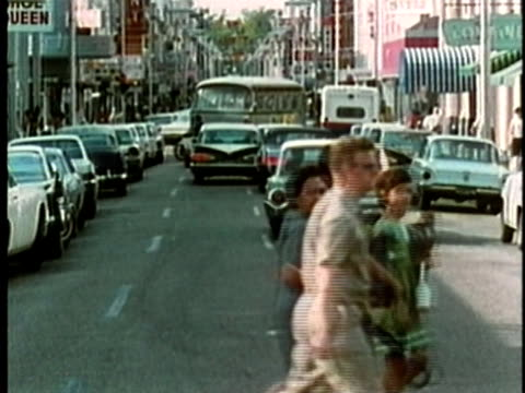 1969 MONTAGE MS Pedestrians crossing city street/ MS People window shopping/ USA/ AUDIO