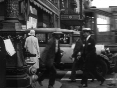 b/w 1930 pedestrians crossing city street to corner / trolley + car traffic in background / los angeles, ca - 1930 stock videos & royalty-free footage