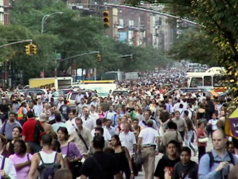 Pedestrians crossing crowded street during citywide blackout on August 14 2003 / New York New York USA / AUDIO