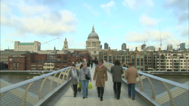 pedestrians crossing millenium bridge towards st. paul's cathedral. - music or celebrities or fashion or film industry or film premiere or youth culture or novelty item or vacations stock videos & royalty-free footage