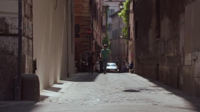 ms pedestrians crossing on street / rome, italy - ラツィオ州点の映像素材/bロール