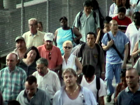 Pedestrians crossing Queensboro Bridge during citywide blackout on August 14 2003 / New York New York USA / AUDIO