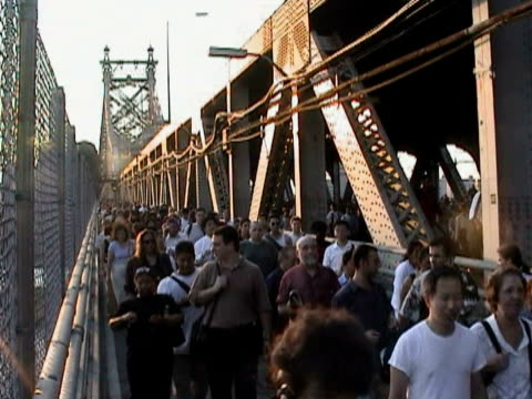 stockvideo's en b-roll-footage met pedestrians crossing queensboro bridge during citywide blackout on august 14, 2003 / new york, new york, usa / audio - 2003