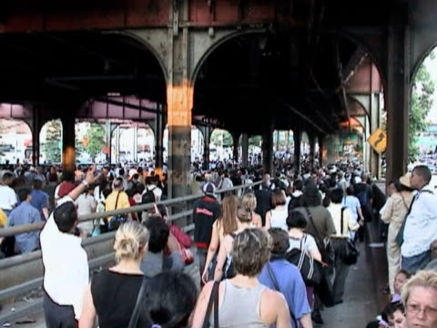 Pedestrians crossing Queensboro Bridge during citywide blackout on August 14 2003 / New York New York USA / AUDIO