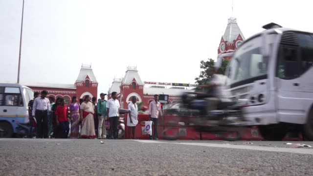 pedestrians crossing road outside chennai central station - chennai stock videos & royalty-free footage