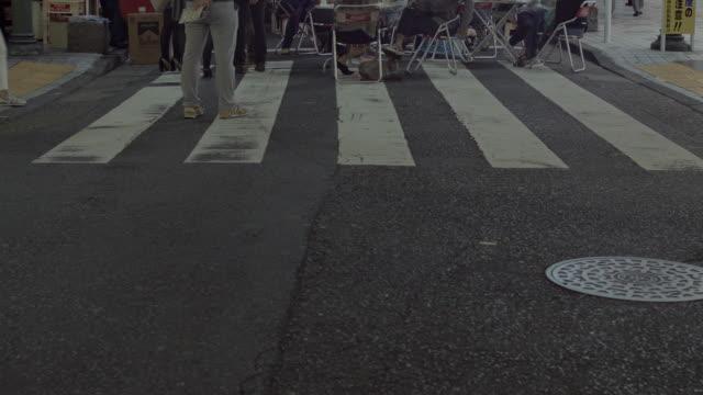 Pedestrians crossing street at crosswalk.