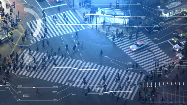 pedestrians crossing street at shibuya intersection aerial view - smart stock videos & royalty-free footage