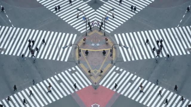 pedestrians crossing street at shibuya intersection aerial view - crosswalk stock videos & royalty-free footage