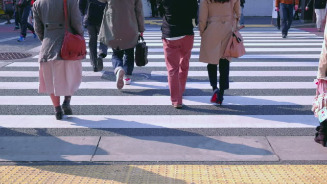 pedestrians crossing street in harajuku. - zebra crossing stock videos & royalty-free footage