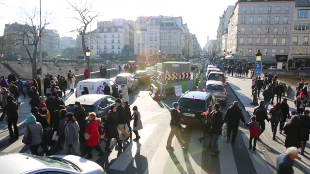 pedestrians crossing street in paris - france stock videos & royalty-free footage