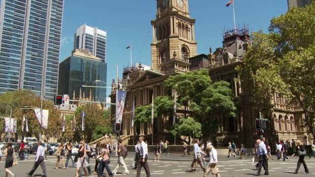 WS TU Pedestrians crossing street intersection near Town Hall / Sydney, New South Wales, Australia