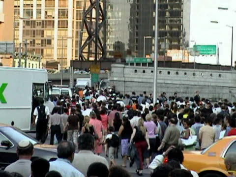 pedestrians crossing street near entrance to queensboro bridge during citywide blackout on august 14, 2003 / new york, new york, usa / audio - 2003 stock videos & royalty-free footage