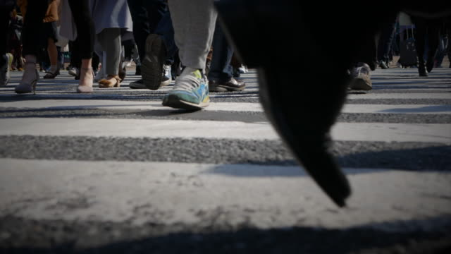 pedestrians crossing street - shibuya ward stock videos & royalty-free footage