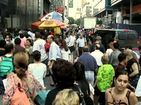 pedestrians crossing street while man preaches on sidewalk during citywide blackout on august 14, 2003 / new york, new york, usa / audio - human limb stock videos & royalty-free footage