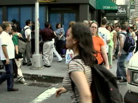 Pedestrians crossing street while vehicle honk in traffic during citywide blackout on August 14 2003 / New York New York USA / AUDIO