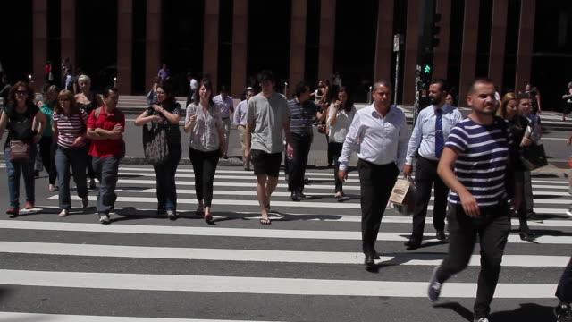 pedestrians crossing the street on the crosswalk on paulista avenue. no audio - avenida paulista stock videos & royalty-free footage
