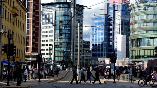 pedestrians crowd a busy street in oslo, norway - bus stock videos & royalty-free footage