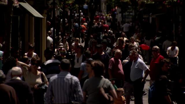 pedestrians crowd the streets of gibraltar. available in hd - gibraltar bildbanksvideor och videomaterial från bakom kulisserna